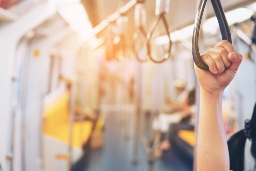 Passenger on bus using handle loop